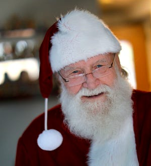 Even Santa needs a little help once in a while: 85-year-old David Lindamood of Duxbury, who for years dressed up like Santa at local events, got some help from Lend A Hand. Greg Derr/The Patriot Ledger