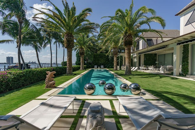 """Landscape designer Keith Williams' new book, """"The Graphic Garden,"""" showcases a number of his designs. The chapter named """"Composed"""" features this lakefront pool area he created for a Palm Beach house."""