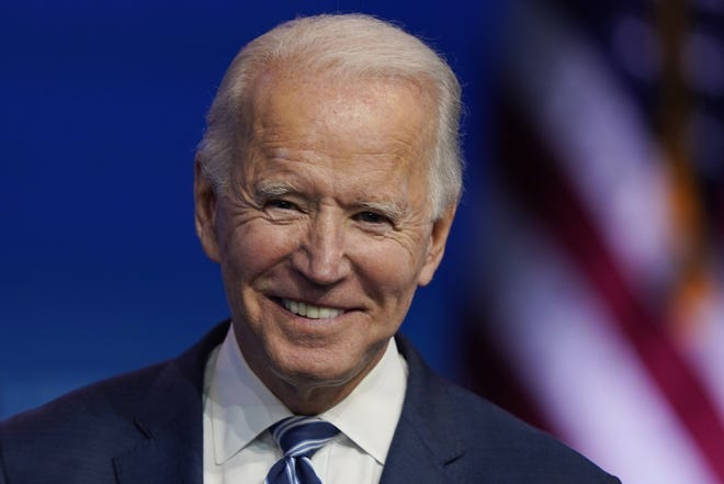 President-elect Joe Biden pauses as listens to media questions at The Queen theater last month in Wilmington, Del. (AP Photo/Carolyn Kaster)