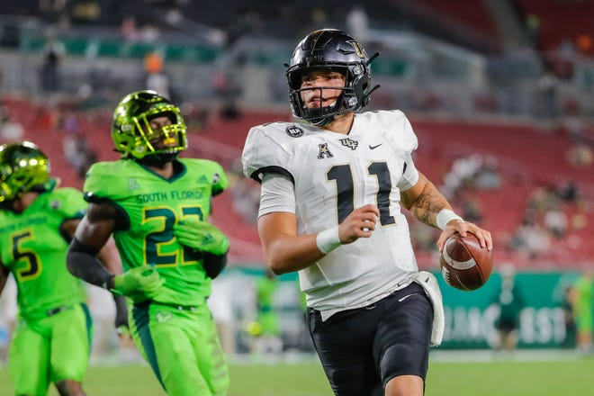 UCF quarterback Dillon Gabriel runs for a touchdown against South Florida last Friday. The Knights finished the season playing nine straight games without interruption.