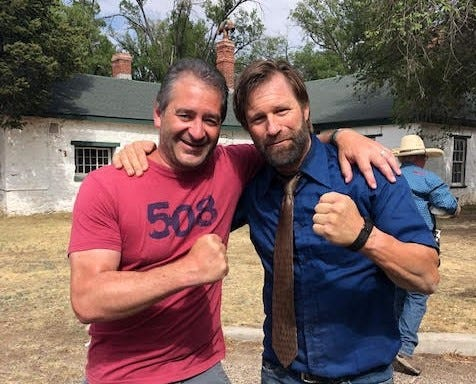 """Actor Aaron Eckhart, right, with Chad Verdi, president and CEO of East Greenwich-based film company Verdi Productions, during filming of """"Wander,"""" which was released Dec. 4."""
