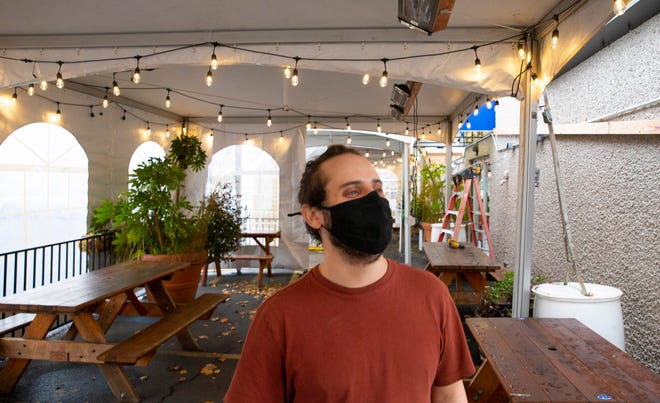 The Bier Stein waiter Justin Robson stands in the new covered area set up outside the restaurant in Eugene.