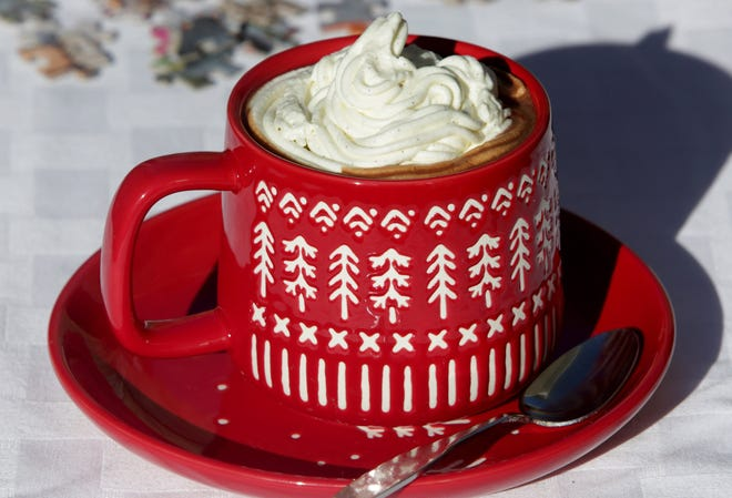Hot chocolate, like this Parisian Hot Chocolate, is topped with Chantilly cream.