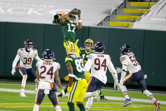 Green Bay Packers' Davante Adams catches a touchdown pass during the first half against the Chicago Bears on Sunday, Nov. 29, 2020, in Green Bay, Wis.