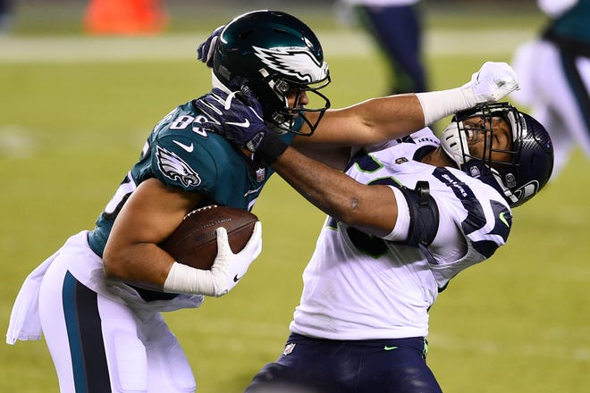 Philadelphia Eagles' Richard Rodgers (85) tries to break free of Seattle Seahawks' K.J. Wright (50) during the second half of an NFL football game, Monday, Nov. 30, 2020, in Philadelphia.