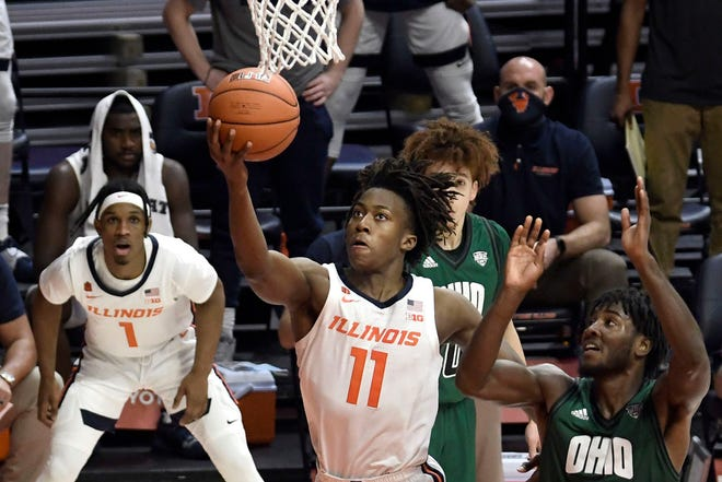 Illinois guard Ayo Dosunmu (11) shoots as Ohio guard Lunden McDay (15) defends in the second half of an NCAA college basketball game Friday, Nov. 27, 2020, in Champaign, Ill.
