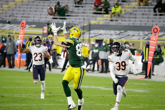 Green Bay Packers' Robert Tonyan catches a touchdown pass during the second half of an NFL football game against the Chicago Bears Sunday, Nov. 29, 2020, in Green Bay, Wis.