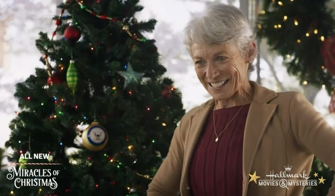 """Ginny MacColl, a resident of St. James, stars in a scene from Hallmark Movies & Mysteries' """"USS Christmas,"""" which shot in Wilmington in September 2020."""