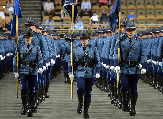 The 84th Recruit Training Troop of the Massachusetts State Police marches into their graduation ceremony at the DCU Center in June 2019. The state police union has voiced opposition to a police reform bill released by lawmakers this week.