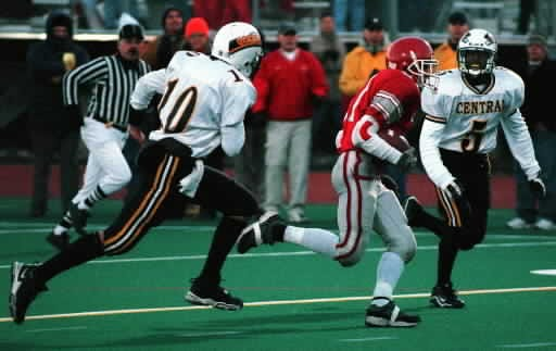 Fitchburg's Ryan Davenport breaks through on a 27-yard touchdown catch in the first quarter of the Central/Western Mass. Division 1 Super Bowl in 2000.