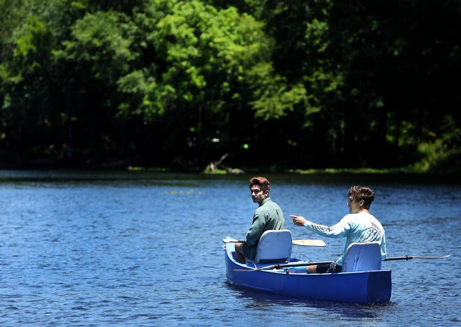 Canoers glide along the Santa Fe River in High Springs in this May 2020 file photo.