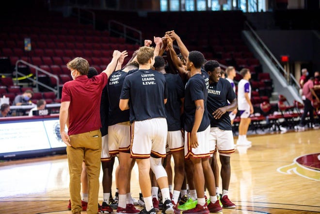 Elon players huddle prior to the start of Saturday's victory against High Point at Schar Center.