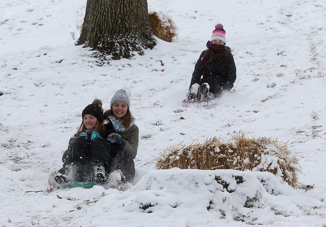 Katelyn and Alexis Mamula and Emma Demuth, all of New Philadelphia, spend some time sled riding at Tuscora Park Tuesday.