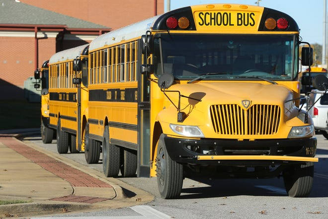 School buses are seen waiting to load at Westlawn Middle School in Tuscaloosa Tuesday, Dec. 1, 2020. [Staff Photo/Gary Cosby Jr.]