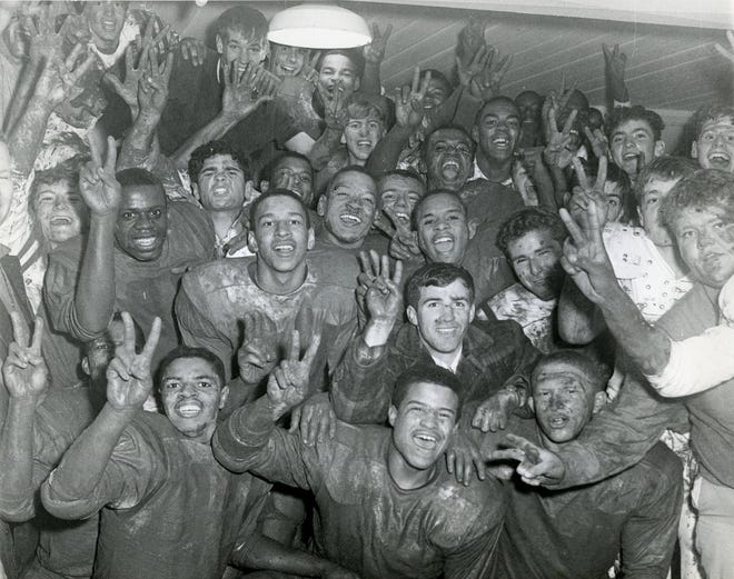Members of the Marion-Franklin High School football team celebrate after defeating Columbus South 18-12 to earn a share of Columbus' City League championship in 1968. Both the Red Devils and Linden-McKinley finished 6-0 in league play. Eastmoor was third at 5-1, with the Bulldogs and Northland going 4-2 to tie for fourth. The first City League championship game was played in 1971.