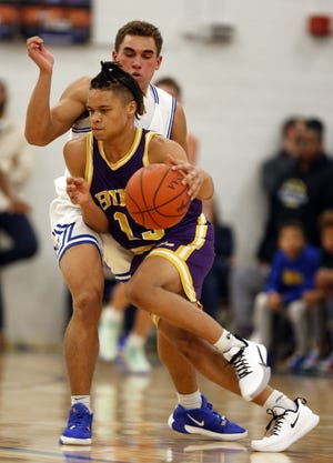 """Junior Julian Heckman and the Reynoldsburg boys basketball team are adjusting to a new coaching staff, led by Andy Moore. """"At the start, we had to get used to the different expectations, but we're improving every day and it's been exciting,"""" Heckman said."""