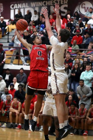 With the start of their season delayed, senior guard Scotty Lomax and Groveport Madison have been building team chemistry during practice. The Cruisers aren't scheduled to play their first game until Jan. 2.