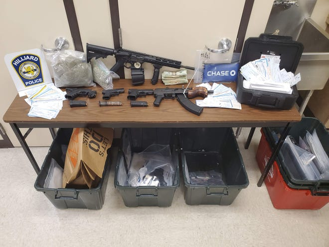 Several firearms, stolen checks and other items were seized June 11 after Hilliard Division of Police used a search warrant on a apartment on Longlining Road in Columbus, just outside New Albany. Fraudulent and stolen documents, two fraudulently purchased vehicles, two pounds of marijuana and $7,129 in cash also were seized.