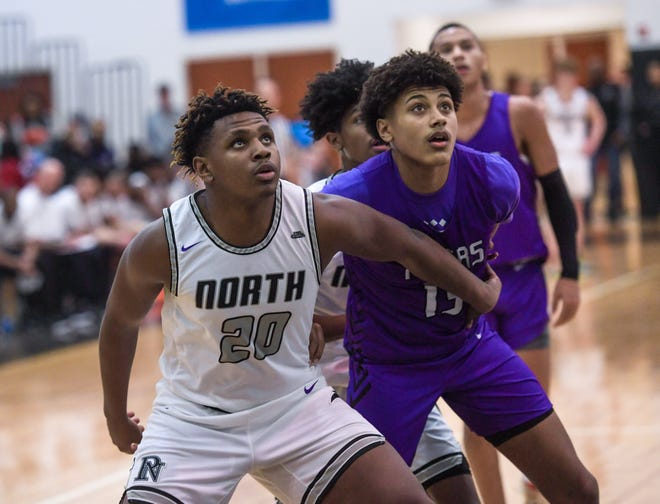 North's Elijah Hawk attempts to box out Central's Devin Royal during a game last season. Both players are among the top returnees for the Panthers and Tigers. North is counting on the 6-foot-4, 240-pound Hawk to be an inside force.