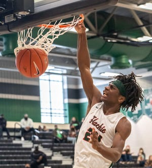 Waxahachie's Montez Young Jr. (24) slams home a dunk with authority during a December game against Lancaster at Mike Turner Gymnasium. The Class 6A No. 1-ranked Runnin' Indians will face No. 9 Killeen Ellison in the Class 6A Region II quarterfinals early next week.