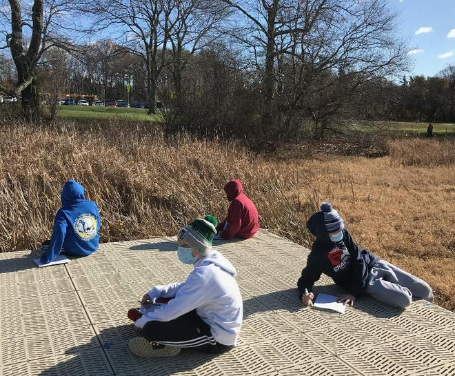 Gates students make observations at the vernal pool during a recent visit.