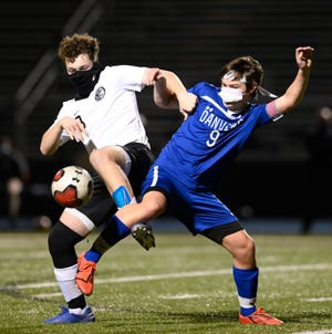 Ian Visnick of Beverly is shown attempting to hold back Dillon Driscoll of Danvers during a game at Danvers High School last November. Visnick is back to begin his third varsity season as a midfielder.