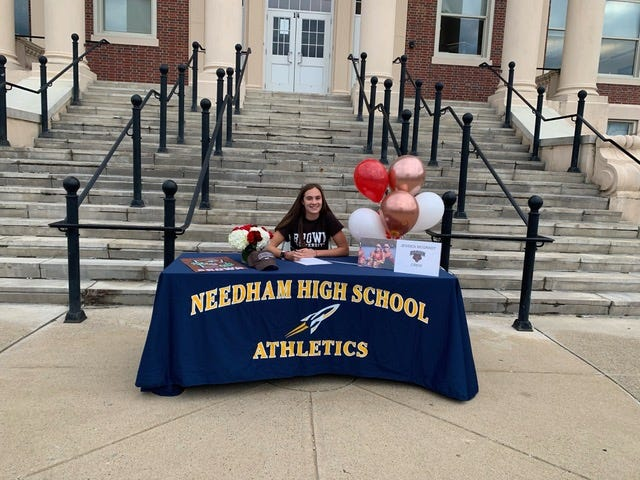 Jessica McGrady, of Needham, commemorates her official commitment to row at Brown University in Providence, Rhode Island.