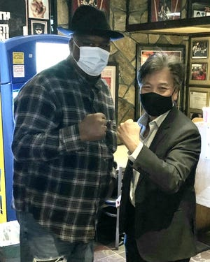 James Buster Douglas, left, stops by Kowloon to hang out with Bobby Wong of Kowloon.