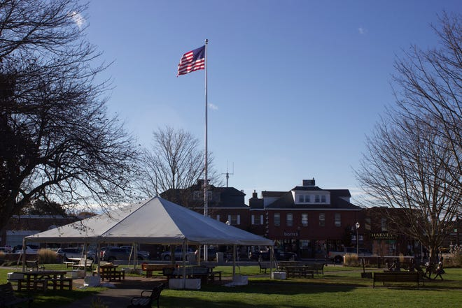 File photo: A tent on the Needham Town Common provides outdoor seating for restaurants in Needham Center. Seeking help beyond local efforts, one Needham chef is calling on Gov. Charlie Baker to do more to help restaurants and bars in the state.