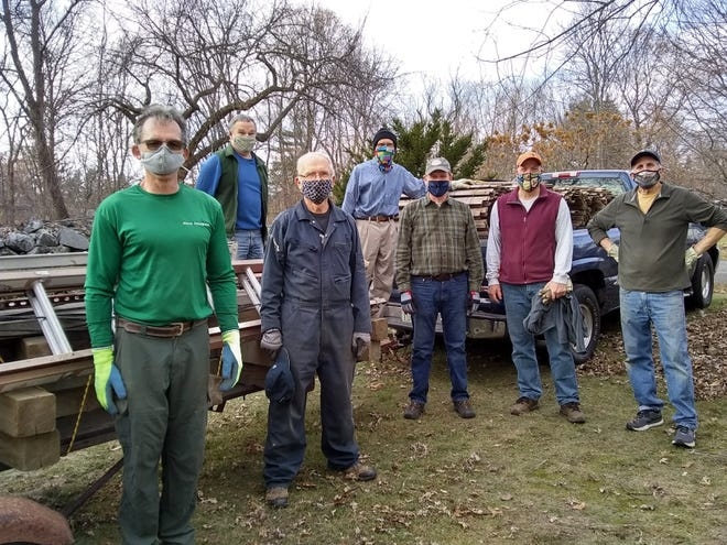 The setup crew for the Christmas tree market at Follen Church.