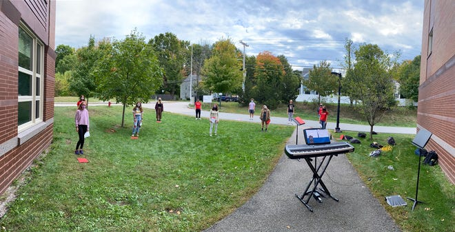 Wellesley High School Choral Program students practicing outside.