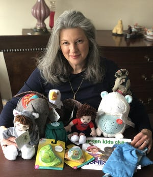Amesbury artist Susan Sofia-McIntire makes plush toys that teach kids about the environment and climate change.