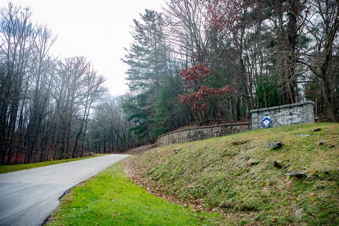 A stone sign marks the entrance to Asheville School on the west side of Asheville on Dec. 1, 2020.