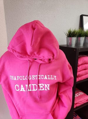 "The Camden Store sells items like this ""Unapologetically Camden"" hoodie and other clothing items for people to show their pride for Camden. This hoodie is a gift idea suggestion from the owners."
