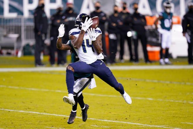Seattle's DK Metcalf catches a pass against Philadelphia's Darius Slay during the first half Monday in Philadelphia. (AP Photo/Chris Szagola)