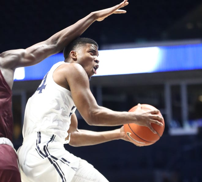 Xavier guard KyKy Tandy drives to the basket against Eastern Kentucky, Monday, Nov. 30, 2020.