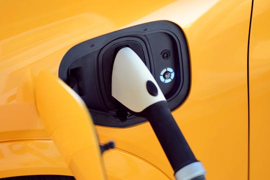 The Mustang Mach-E GT Performance Edition targets an EPA estimated range of 235 miles.  Ford's charging network provides access to more than 13,500 charging stations.  This is a picture of the charging port, which replaces the traditional petrol tank.