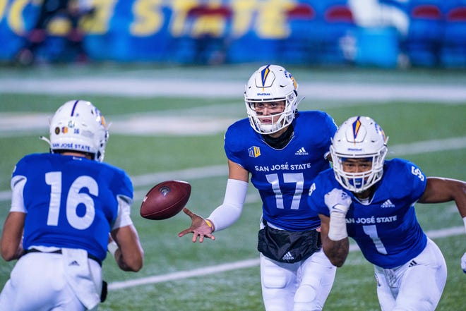 San Jose State quarterback Nick Starkel (17) tosses the football to fellow quarterback Nick Nash (16) during a Nov. 14, 2020, win over UNLV at CEFCU Stadium in San Jose, Calif. The Spartans are 4-0 and the only unbeaten football team in the Mountain West.