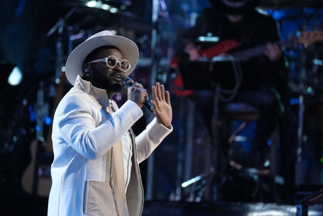 "John Holiday performs ""Fly Me to the Moon"" during the live playoffs of ""The Voice"" on Monday. The Appleton singer is one of nine remaining contestants."