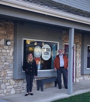 Barbara Pfeifer and Dane Carter of Bank of Luxemburg stand outside the bank's new Fish Creek branch that will open in the spring. Pfeifer, now retail office manager in Sturgeon Bay, will oversee the Fish Creek office.