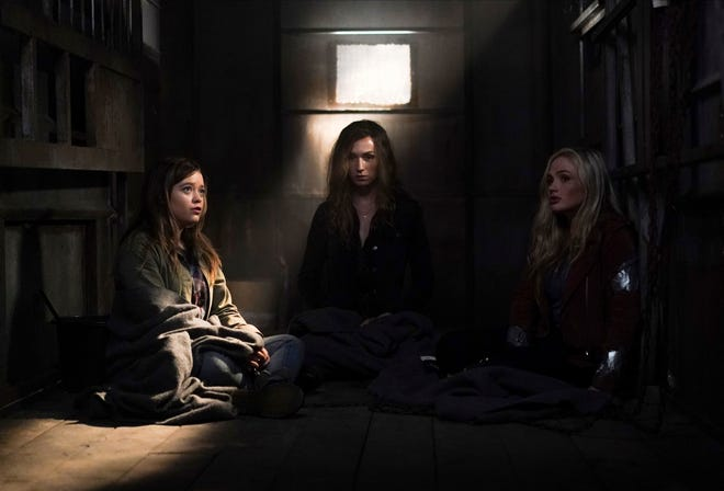 """This image released by ABC shows  Jade Pettyjohn, from left, Jesse James Keitel and Natalie Alyn Lind in a scene from """"Big Sky."""""""