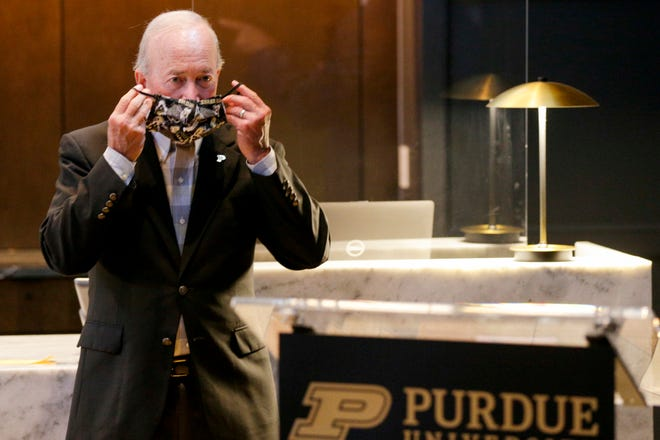Purdue president Mitch Daniels dons his mask after speaking at the Union Club Hotel opening ceremonies, Wednesday, Aug. 5, 2020 in West Lafayette.