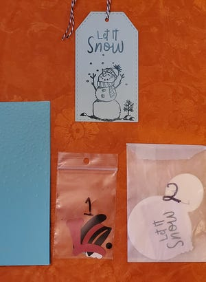 December's Art Ability Bag comes with construction paper and pieces needed to create a snowman