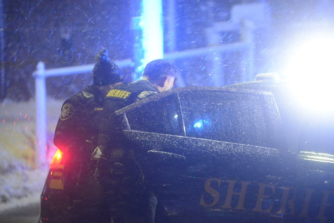Mansfield police and the Richland County Sheriff's Office searched two houses in the 200 block of Grace Street on Monday evening as a winter storm moved across northern Ohio.