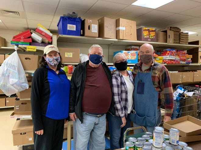 Volunteers at the food pantry at Germantown's St. Boniface Catholic Parish have volunteered extra hours to provide individual grocery bags during the pandemic. Pictured left to right, Ann Bastow, Jim Chrisien, Pat Hilgers and Mike Hilgers.
