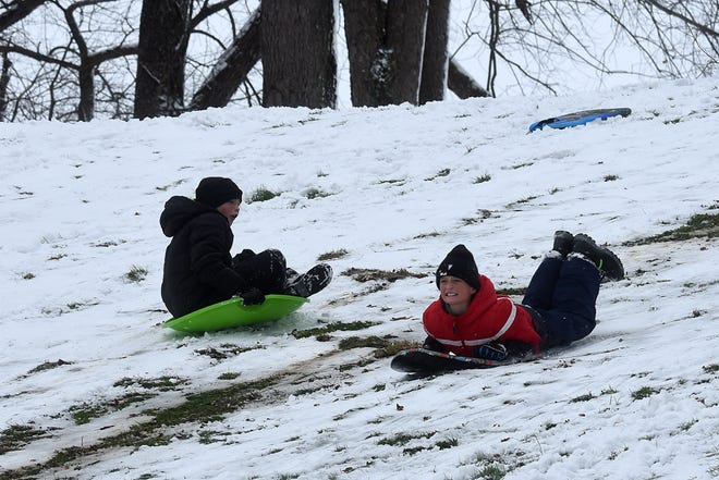 Siblings Hayden and Brylan Spring race down the hill at Heath's Geller Park while enjoying some snow day sledding on Tuesday, Dec. 1, 2020. The first major snowfall this winter hit Licking County overnight as November became December.