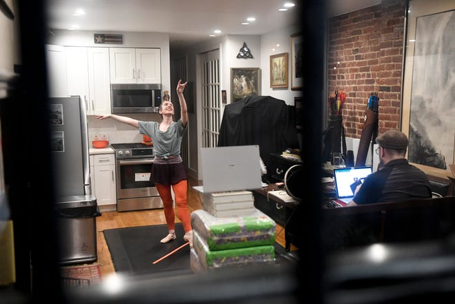 Krishna Washburn teaches her 'Dark Room Ballet' class, a virtual ballet class for blind and visually impaired people, from her kitchen in New York on Monday, Nov. 30, 2020.
