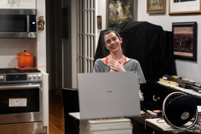 """Krishna Washburn talks with students before her virtual """"Dark Room Ballet"""" class begins in her New York City home on Monday, Nov. 30, 2020."""