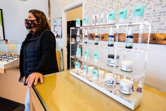 Mara McCalmon, who owns Thumb Coast CBD with her husband Kyle, talks about some of their products Tuesday, Dec. 1, 2020, in the store.