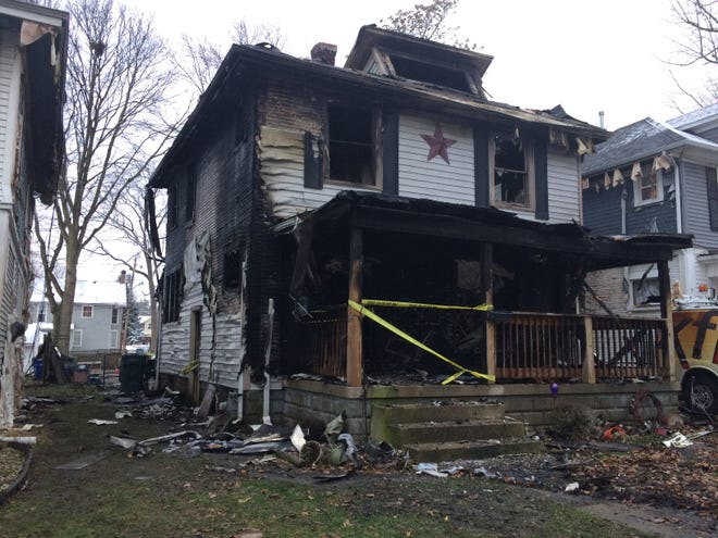 Fire destroyed a vacant house in the 600 block of West Main Street early Tuesday, Dec. 1, 2020. The fire also damaged both neighboring homes.